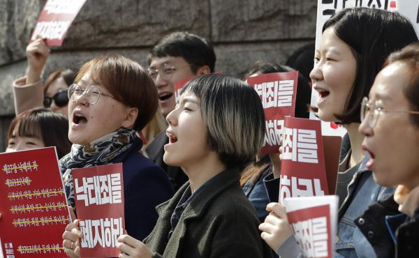 Protesters celebrate after listening to a judgment during a rally demanding the abolition of South Korea's abortion law outside of the Constitutional Court in Seoul on Thursday.