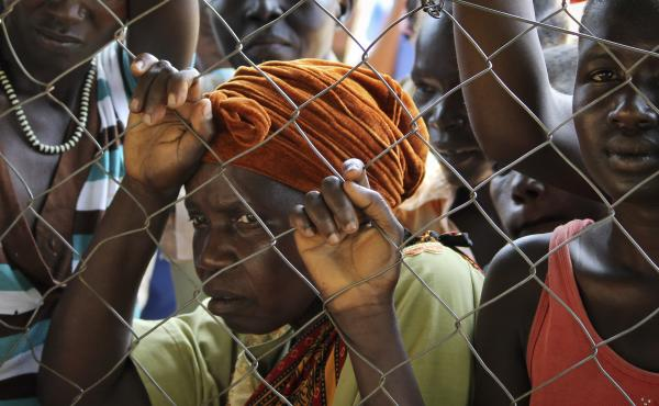 In this photo taken Monday, Nov. 14, 2016, women stand outside a U.N. Refugee Agency site in Yei, in southern South Sudan. The formerly peaceful town of Yei is now a center of the renewed civil war.
