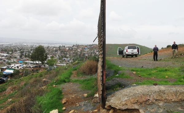 This fence, made of circa-Vietnam War era surplus landing mats, ends at Otay Mesa about 15 miles east of the Pacific Ocean. Tijuana is on the left and California on the right. There are two other kinds of fencing along the U.S.-Mexico border: steel mesh a