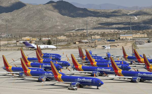 Southwest Airlines Boeing 737 Max aircraft are parked on the tarmac after being grounded, at the Southern California Logistics Airport in Victorville, Calif., in March.