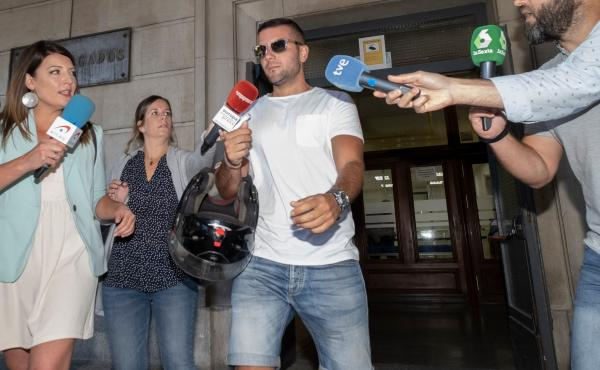 """Journalists surround Ángel Boza, one of five members of the """"Wolf Pack,"""" on Friday. Spain's Supreme Court found the five men guilty of gang rape, overturning previous convictions on the lesser offense of sexual abuse in a case that shook the country."""
