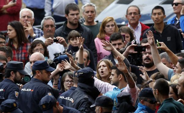 Spanish police block animal rights activists protesting Wednesday outside the apartment building of the Spanish nurse who contracted Ebola in the city of Alcorcon, outside Madrid.