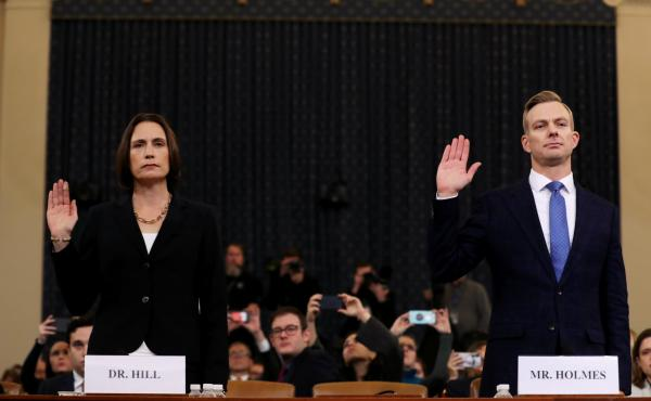 Fiona Hill (left), the National Security Council's former senior director for Europe and Russia, and David Holmes, an official from the American Embassy in Ukraine, are sworn in to testify before the House Intelligence Committee in the Longworth House Off