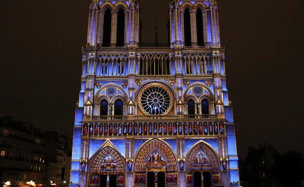 The show celebrates the Gothic cathedral's role in French history as well as the end of the First World War.