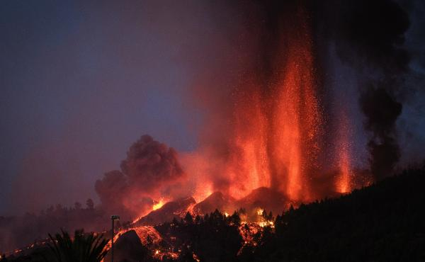 Cumbre Vieja erupts, spewing out columns of smoke, ash and lava, as seen from Los Llanos de Aridane municipality on the Canary island of La Palma on Sunday.