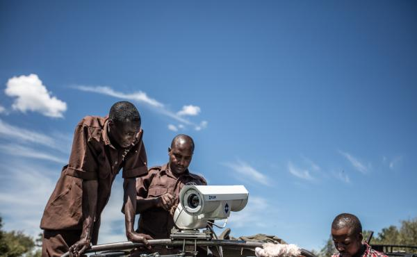 Field technicians at Mara Conservancy install a mobile camera unit to help nab poachers.