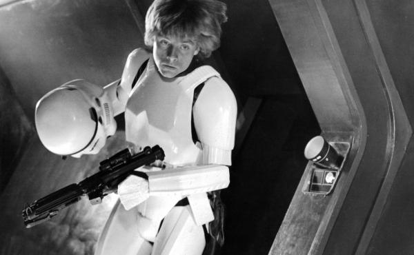 Mark Hamill takes off his storm trooper helmet in a scene from the film Star Wars.