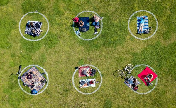 Communication skills used to negotiate safe sex are also useful for setting boundaries while socializing during the COVID-19 pandemic. Above, circles drawn in the grass encourage social distancing at Dolores Park in San Francisco.