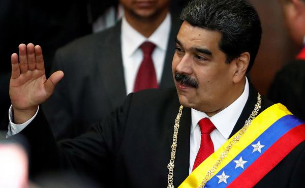 Venezuela's sitting president, Nicolás Maduro, attends a ceremony Thursday in Caracas to mark the opening of the judicial year at the Supreme Court of Justice. Opposition leader Juan Guaidó has declared himself the interim president, but Maduro has not