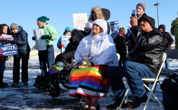 Fort Peck Assiniboine and Sioux council member Patricia Iron Cloud (center) watches protesters make speeches against the Keystone XL pipeline.