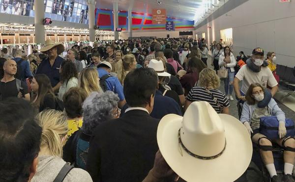 People waited in line to go through the customs at Dallas/Fort Worth International Airport on Saturday as staff took extra precautions to guard against the coronavirus.
