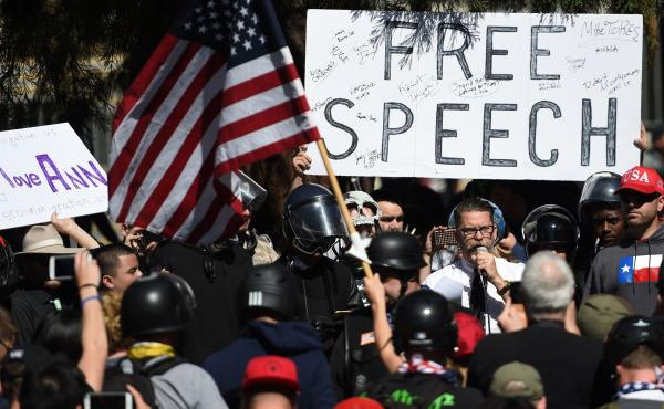 Vice Media co-founder and conservative speaker Gavin McInnes reads a speech written by Ann Coulter to a crowd during a conservative rally in Berkeley, Calif., on April 27. Coulter canceled a planned appearance at the University of California, Berkeley, sa