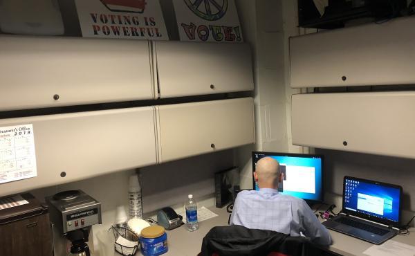 A member of the West Virginia National Guard works in the basement of the state Capitol in Charleston, W.Va., on secondment to the Secretary of State's office to work on cybersecurity around state elections.