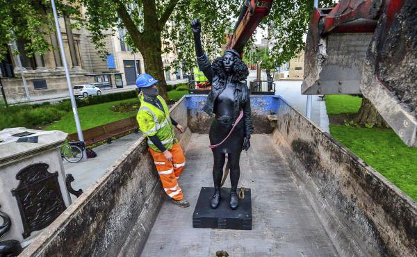 Contractors on Thursday remove Marc Quinn's statue, A Surge of Power (Jen Reid) 2020, after its temporary stint atop the plinth dedicated to slave trader Edward Colston in Bristol. Officials in the British city said the sculpture had been set up without t