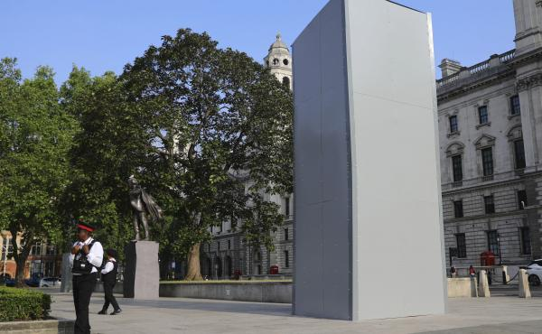 A protective covering was installed overnight to keep protesters from further damaging a statue of former British Prime Minister Winston Churchill in Parliament Square in London.