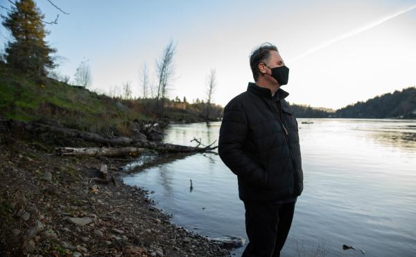 Joel McLemore of Milwaukie, Ore., looks at the Willamette River near his home in suburban Portland, Ore. McLemore moved to Oregon in April to pursue new employment opportunities after his divorce.