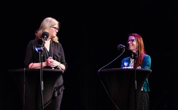 Contestants Christine Whalen and Wendi Aarons appear on Ask Me Another at the Paramount Theatre in Austin, Texas.