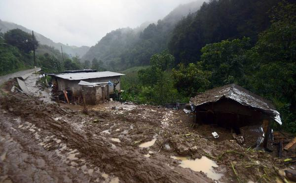 A photo shows the community of Coscomatepec, Veracruz, in eastern Mexico on Saturday. Homes were buried by landslides following heavy rains from Earl, which reached Mexican territory on Thursday as a tropical storm.