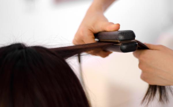 It's the heat that straightens the hair. But too much, and hair can be permanently limp, or burned.