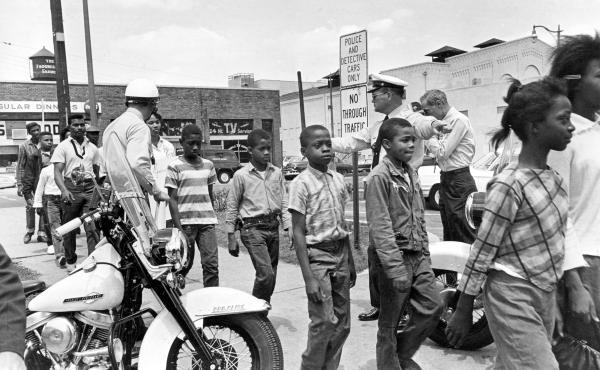 In 1963, policemen in Birmingham, Ala., arrested black school children who were protesting racial discrimination.