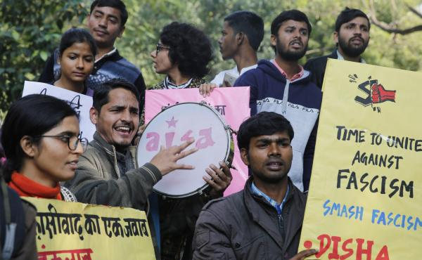 Allahabad University students in Prayagraj, India, on Monday hold placards during a protest against an attack by masked assailants at New Delhi's Jawaharlal Nehru University over the weekend.