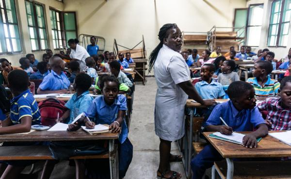 Seventh-grade teachers Rita Ibrahim John, left, and Anotinia Marquez Bero, right, must share a single room to teach their two classes. Cyclone Idai destroyed 32 classrooms at Eduardo Mondlane Primary Completion School in Mozambique.