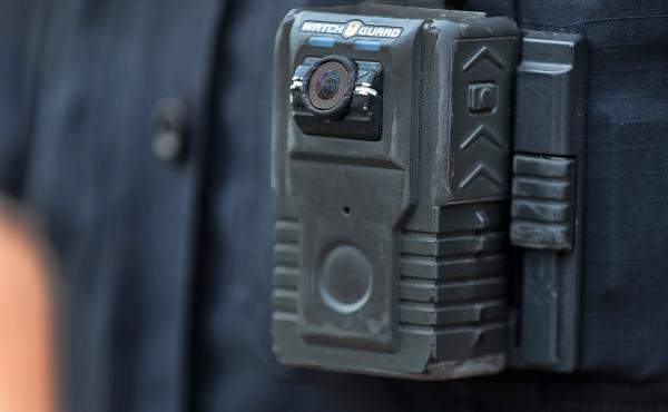 Police officer David Moore is pictured wearing a body camera in Ipswich, Mass., on Dec. 1, 2020. The city was among 25 statewide awarded grants to purchase body-worn cameras for videotaping interactions with the public. A new study says the benefits to so