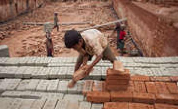 Babu, 8, works at a brick factory in Narayanganj, Bangladesh.