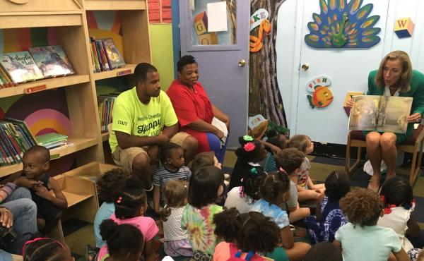 Pennsylvania Democratic Senate candidate Katie McGinty reads to children at the Western Learning Center during a campaign stop in Philadelphia.