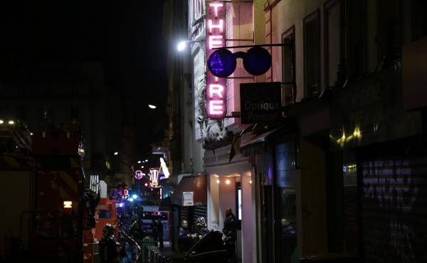 Police and rescuers survey the area around the Bataclan Theater after a coordinated attack in Paris on November 13.