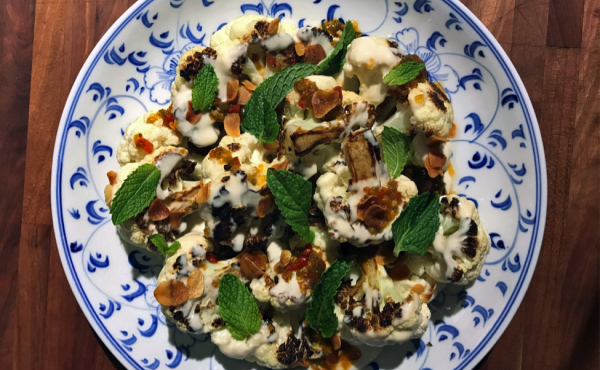 Charred Cauliflower with tahini vinaigrette with hot pepper jelly, crispy garlic, and mint.