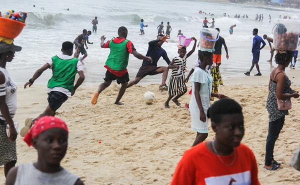 Soccer on the sand of Lumley Beach is a big Sunday pastime in Freetown, Sierra Leone. Pick-up games run up and down the shoreline.