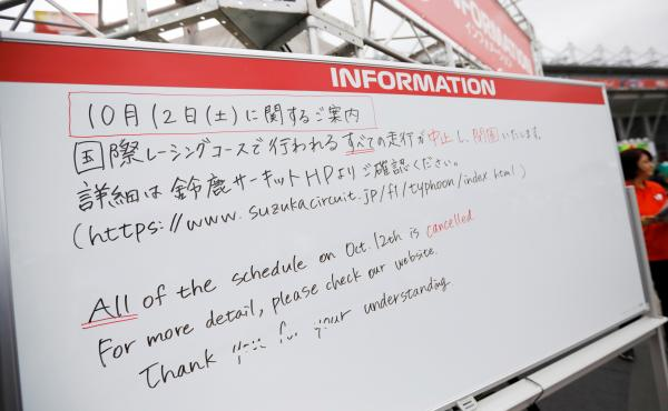 An information board announcing the cancellation of all practice and qualifying sessions scheduled for Saturday due to the approach of Typhoon Hagibis, is displayed at Formula One Japanese Grand Prix at Suzuka Circuit in Suzuka, central Japan, on Friday.
