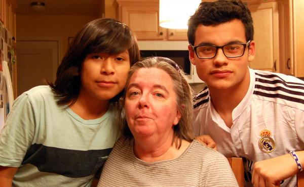 Kathy Hanlon and her sons, Sergio (left) and Cristian, were traumatized by Superstorm Sandy. Hanlon says her flood insurance company made life after Sandy even more horrible