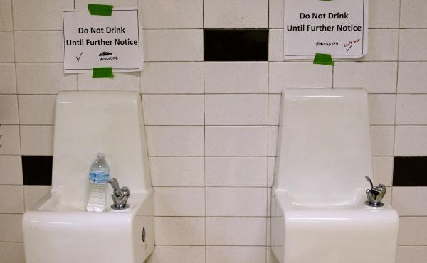 "Drinking fountains are marked ""Do Not Drink Until Further Notice"" at Flint Northwestern High School in Flint, Mich., in May 2016. After 18 months of insisting that water drawn from the Flint River was safe to drink, officials admitted it was not."