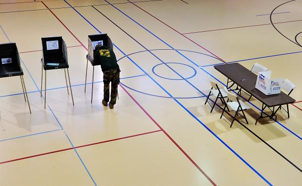 A man votes in November in Durham, N.C. The U.S. Supreme Court had refused to reinstate strict voter restrictions in time for Election Day.