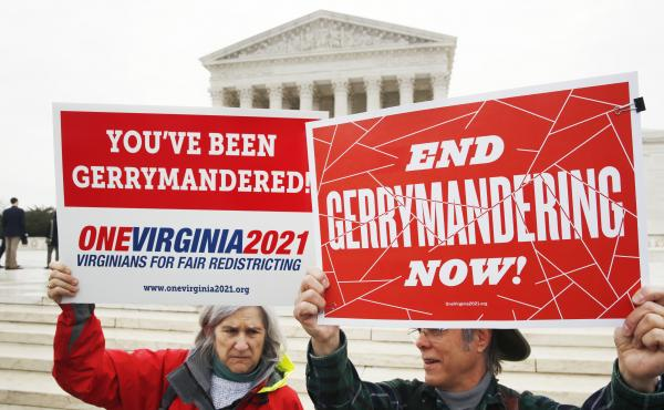 Sara Fitzgerald (left) and Michael Martin, both with the group One Virginia, protest gerrymandering in front of the Supreme Court in March.