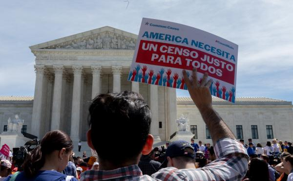 Protesters carrying signs about the census gather outside the U.S. Supreme Court in 2019. Immigrant rights advocates have vowed to continue fighting President Trump's proposal.