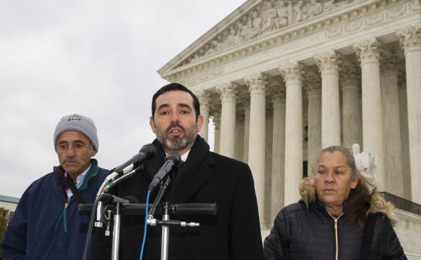 Attorney Cristobal Galindo, center, is accompanied by Jesus Hernandez, left, and Maria Guereca, and attorney Marion Reilly in front of the Supreme Court, in Nov. 2019.
