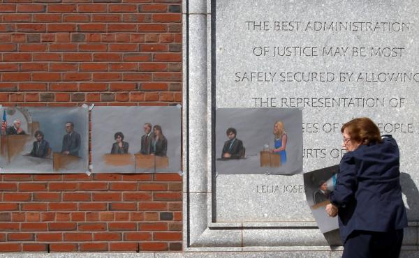 The U.S. Supreme Court will review a lower court's decision from last summer that vacated the six death sentences imposed on Boston Marathon bomber Dzhokhar Tsarnaev. Here, artist Jane Flavell Collins pulls down her courtroom sketches outside the Moakley