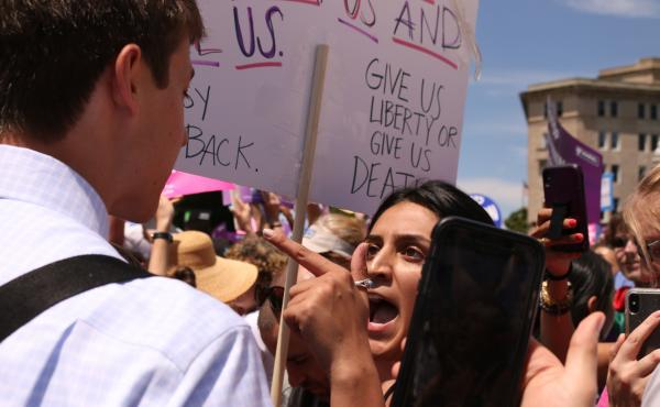 An abortion-rights supporter argues with an anti-abortion-rights protester in front of the U.S. Supreme Court on May 21 during demonstrations in defense of abortion rights.