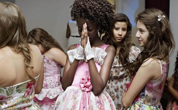 Maysa prays before her turn on stage during the final contest for Young Miss Sao Paulo 2015.