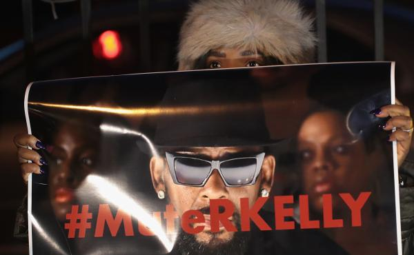 Demonstrators gather near the studio of singer R. Kelly to call for a boycott of his music on Jan. 9, 2019 after allegations of sexual abuse against young girls were raised on the Lifetime docuseries Surviving R. Kelly.