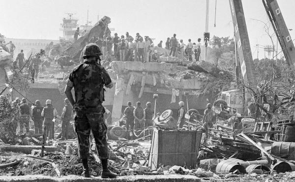 In October 1983, rescuers probe the wreckage of the U.S. Marine command building near the Beirut airport, a day after a terrorist attack killed 241 U.S. service members.