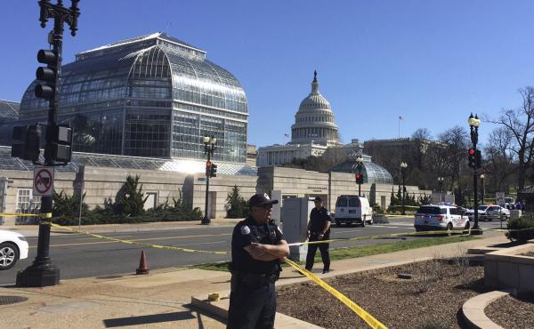 Police stand guard at the Botanical Gardens after the incident near the U.S. Capitol on Wednesday.