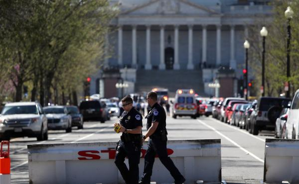 Police establish a perimeter during a lockdown during the emergency at the U.S. Capitol Visitor Center on Monday.