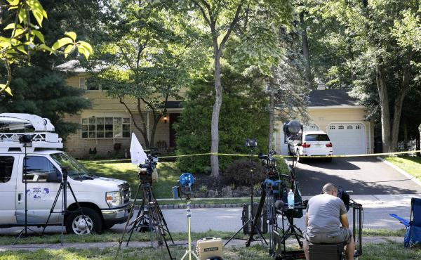 News media set up in front of the home of U.S. District Judge Esther Salas on Monday in North Brunswick, N.J. A gunman posing as a delivery person shot and killed Salas' 20-year-old son Sunday.