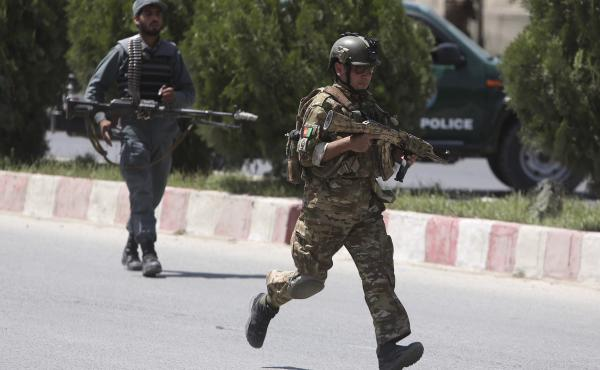 Security personnel arrive at the site of an attack in the Afghan Interior Ministry in Kabul, Afghanistan, on Wednesday.