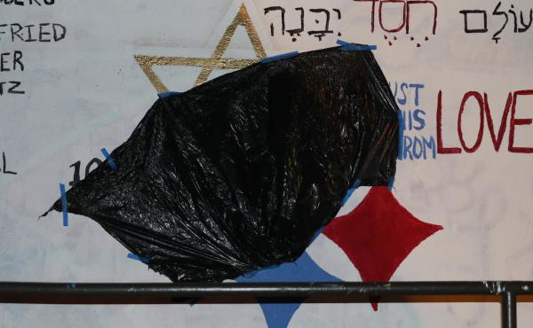 A black trash bag covers a red swastika painted over a mural at Duke University. Dedicated to the victims of the Pittsburgh synagogue shooting, the original mural replaced the yellow star in the Pittsburgh Steelers' emblem with the Star of David and read,