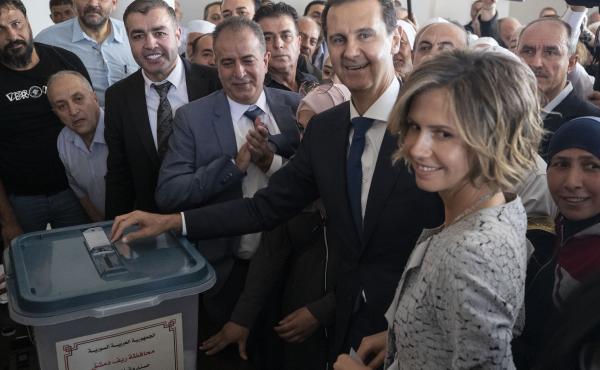 Syrian President Bashar Assad and his wife, Asma, vote at a polling station during the presidential election Wednesday in Douma, near the Syrian capital of Damascus.